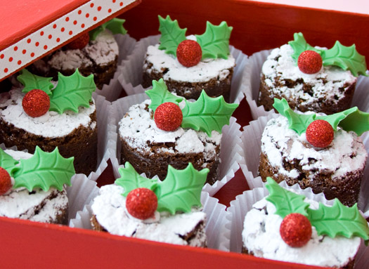 Christmas Cake Topped With Powdered Sugar And Holly