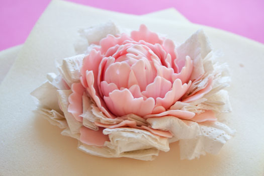 Separating petals on a gum paste peony