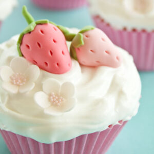 Cupcakes decorated with gum paste strawberries