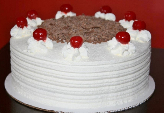 Decorating A Birthday Cake With Whipped Cream Frosting