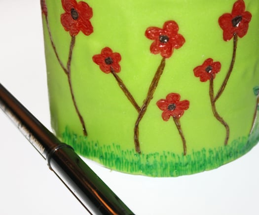 how to draw on a spring themed cake with edible markers 7