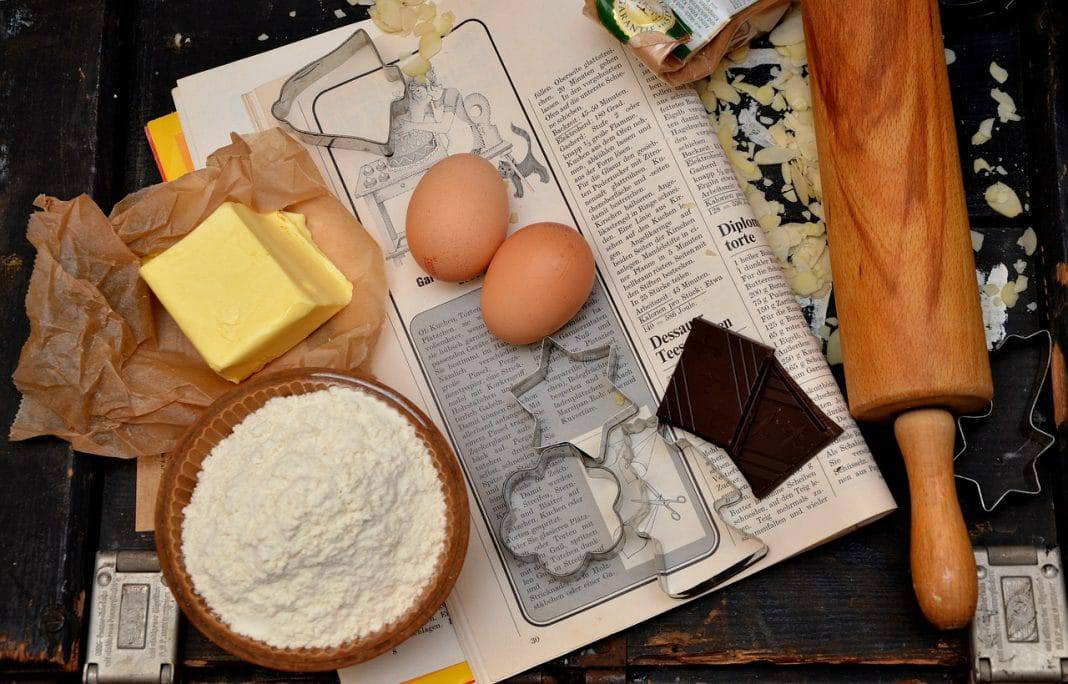 Flour, butter and eggs as ingredients for cookies