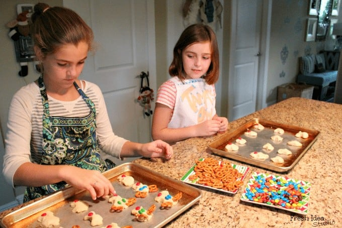 Kids doing monster cookie recipe