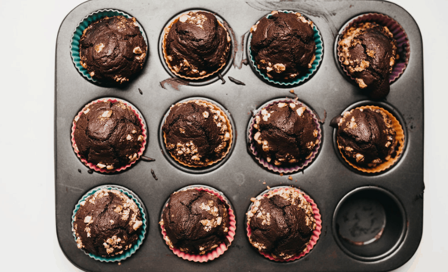 freshly baked chocolate muffin in a baking pan