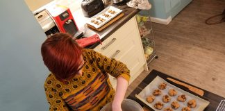 woman using a cookie scoop to get uniform cookies