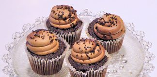 A plate filled with chocolate cupcakes
